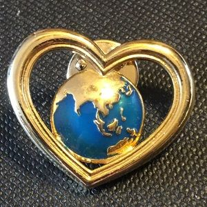 Vintage Avon world with heart pin